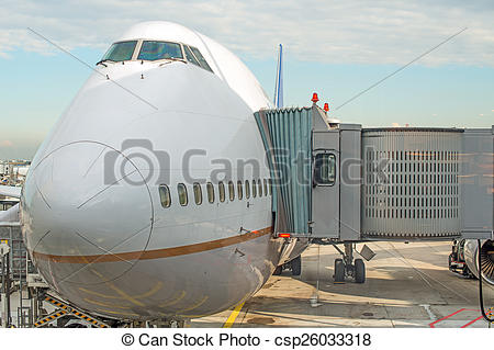 Stock Photography of Jet bridge docked the plane at the airport.