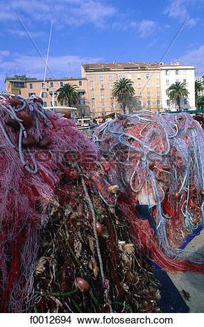 Stock Photo of Corsica, Ajaccio, harbour, fishing nets f0012694.