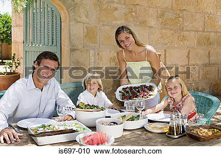 Stock Photography of Family dining al fresco is697.
