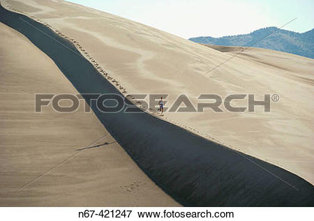Picture of Woman running, Great Sand Dunes National Park near.
