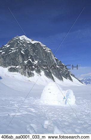Stock Photo of Alaska Range Mtns Glacier Igloo White Snow Ice Sky.
