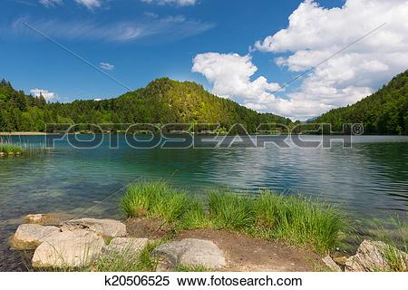 Stock Image of sunny spot on mountain at lake alatsee with rocks.