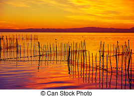 Stock Photo of La Albufera lake sunset in El Saler of Valencia at.