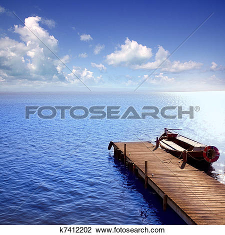 Stock Photo of Albufera blue boats lake in El Saler Valencia.
