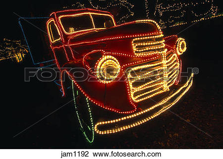 Stock Photo of Car lit up with christmas lights at the River of.