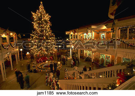 Stock Image of Christmas decor at night in Old Town Albuquerque.