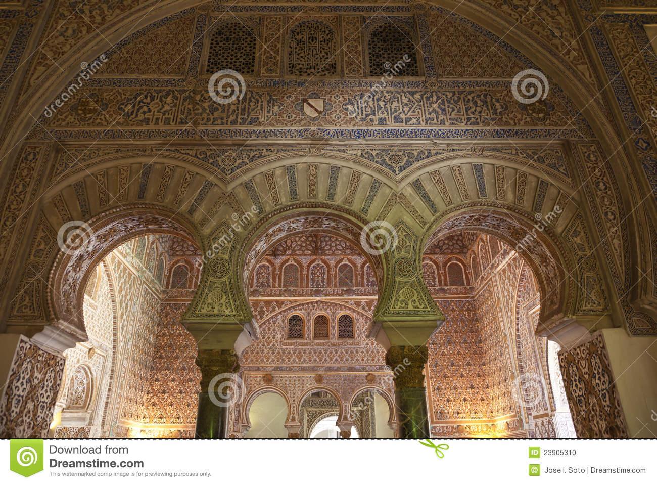 Mudejar Arches In The Royal Alcazar Of Sevilla Stock Photo.