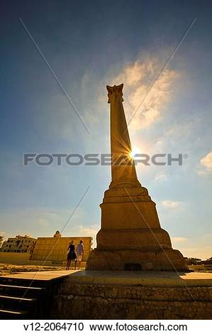 Stock Photography of Egypt, Alexandria, Pompey's Pillar and Sphinx.