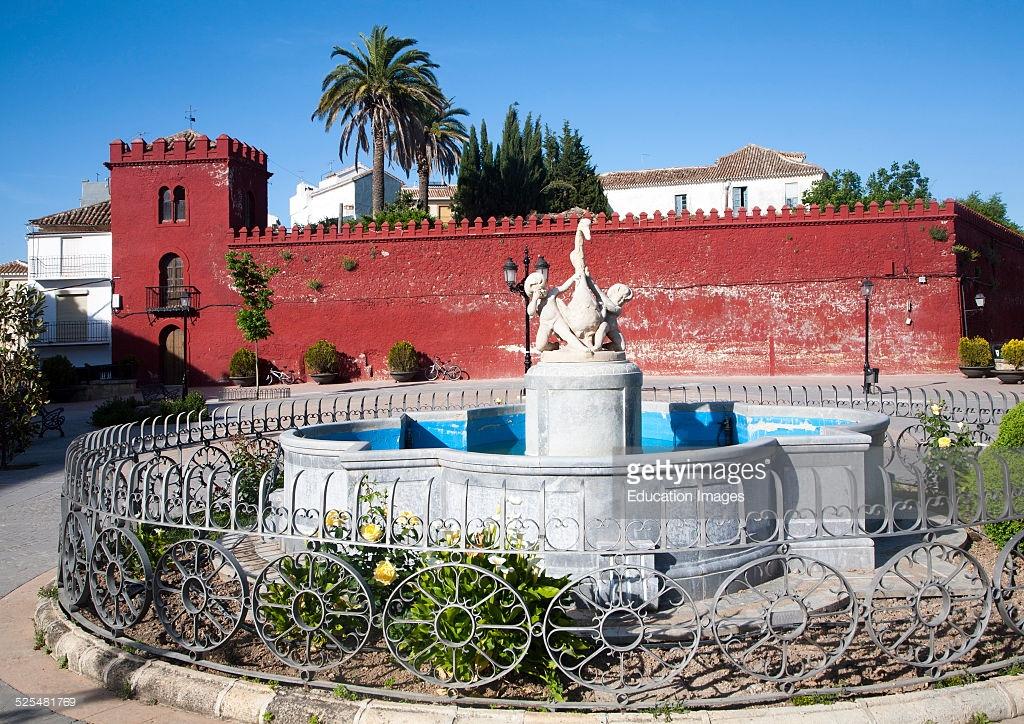 Moorish red castle walls in Plaza de la Constitucion, Alhama de.