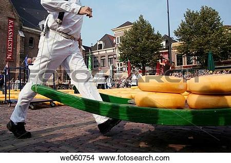 Stock Photo of Running carriers with cheese on pallet, cheese.