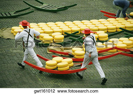 Stock Photo of High angle view of two men carrying cheese, Alkmaar.