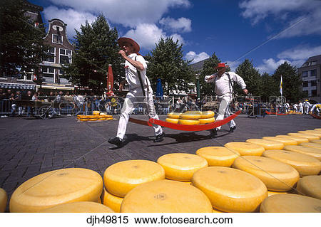Stock Image of Holland, Alkmaar, Cheese Market, Carrying Cheese.