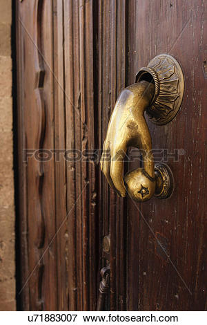 Picture of Detail shot of closed door with designed handle; San.