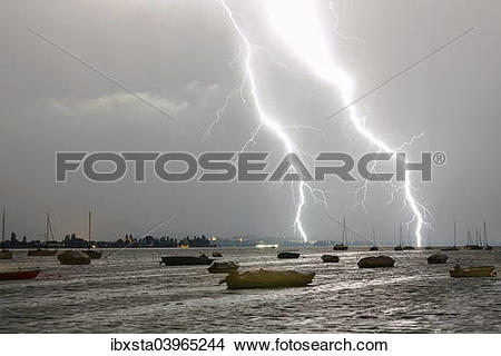 """Stock Photo of """"Thunderstorms with lightning, summer evening."""