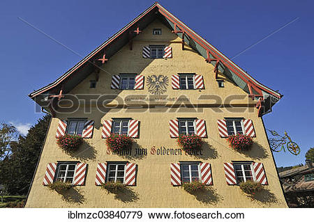 """Stock Photograph of """"Shingle facade with windows and flower boxes."""