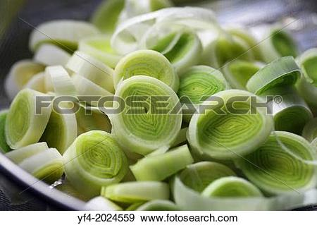 Stock Photograph of Leeks (Allium porrum), a vegetable, sliced in.