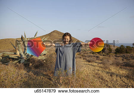 Stock Photograph of Girl holding bright shapes in desert, Cabo de.