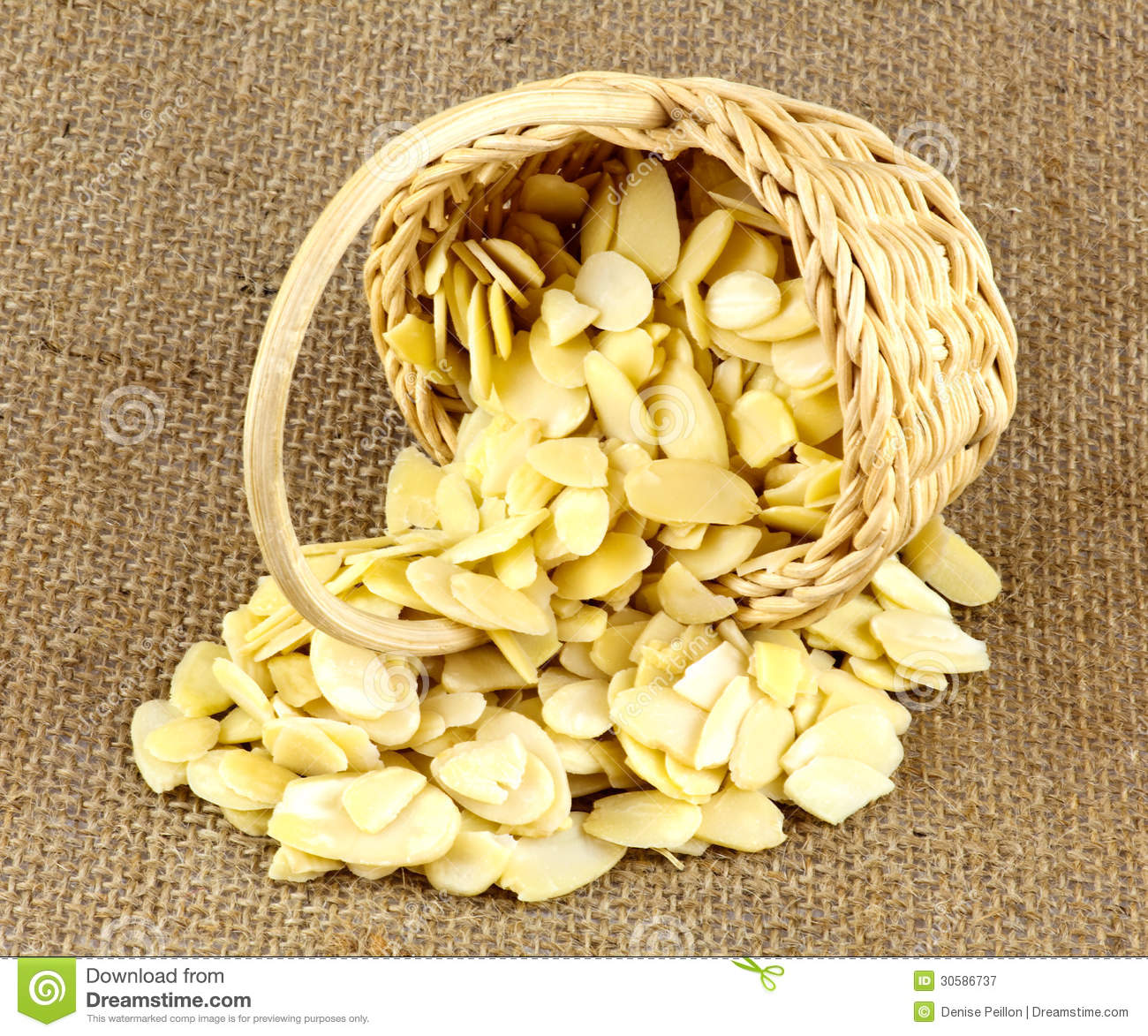Almond Slices In Wicker Basket Royalty Free Stock Photography.