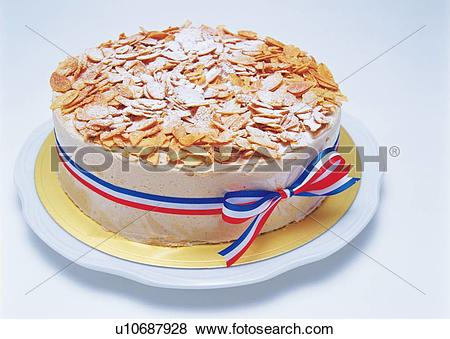 Pictures of Cake strewed with almond slices, Wrapped by ribbon.