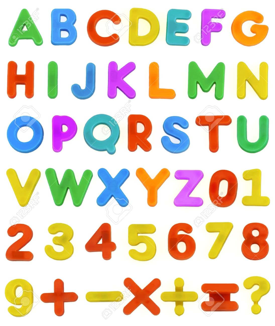 A Child's Magnetic Plastic ABC Letters Laid Out Alphabetically.