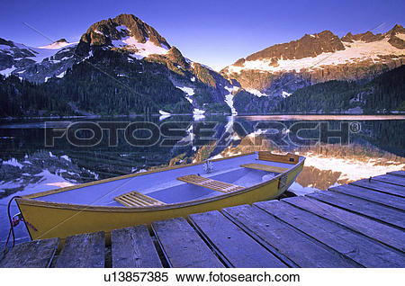 Stock Image of Rowboat at the Alpine Club of Canada cabin dock on.