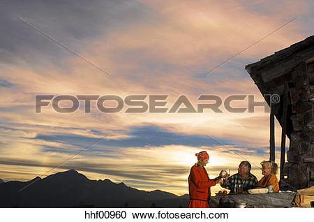 Stock Photography of Couple taking break at alpine hut, peasant.