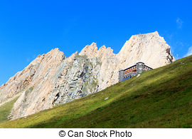 Stock Photography of Alpine hut Sajathutte and mountain Rote Saule.