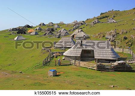 Stock Image of Wooden alpine huts.