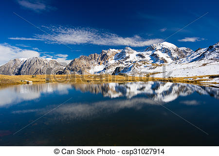 Stock Photography of High altitude blue alpine lake in autumn.
