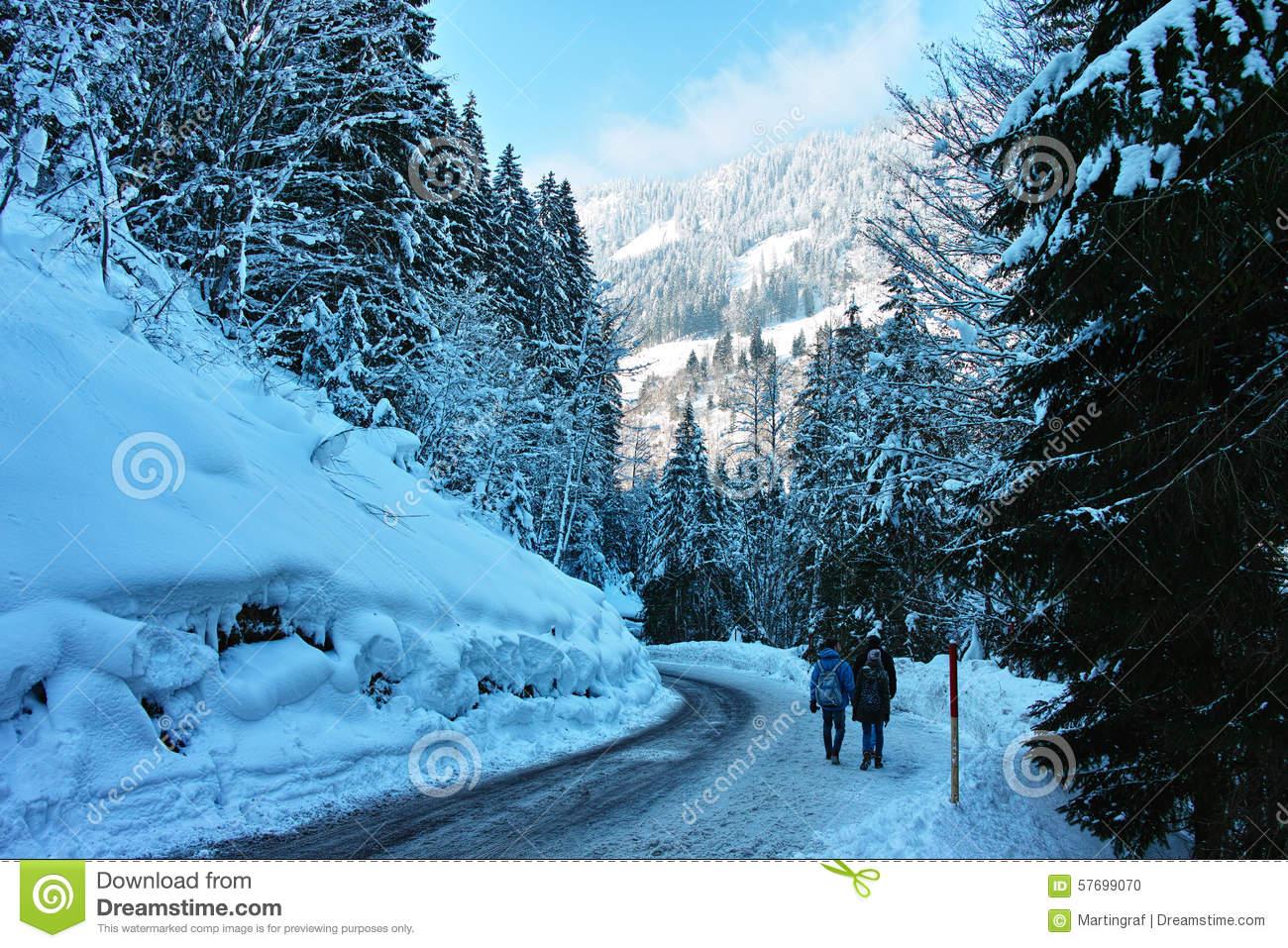 Walking On Slippery Road In Snowy Alpine Landscape Stock Photo.