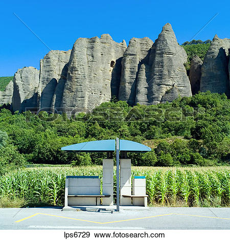 Stock Photograph of bus stop and rochers des mees cliff and rock.