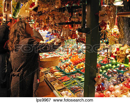 Picture of CHRISTMAS DECORATIVE PROPS STALL AND PEOPLE AT.