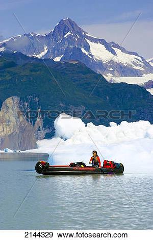 Stock Photograph of Woman In Inflatable Canoe Among Icebergs On.