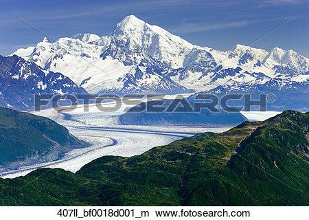 Stock Photo of Aerial of Alsek Glacier winding below Mt.