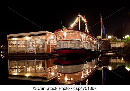 Picture of Ship and cafes are at night on the black waters of Lake.