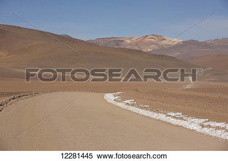 Stock Image of A road winds it's way through the high desert of.