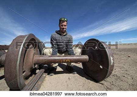 Picture of Young man lifting train axle like dumbbell, Cementerio.
