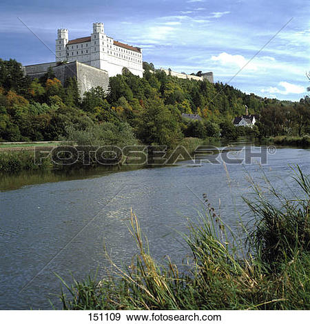 Stock Photograph of Castle on hill with river flowing besides.