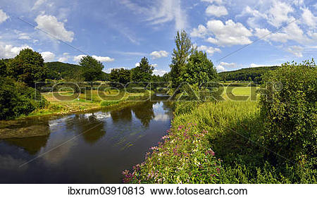 """Stock Photo of """"Altmuhlt river flows between green fields and."""