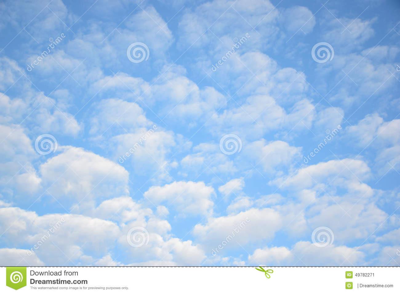 Altocumulus Clouds In Blue Sky Stock Photo.