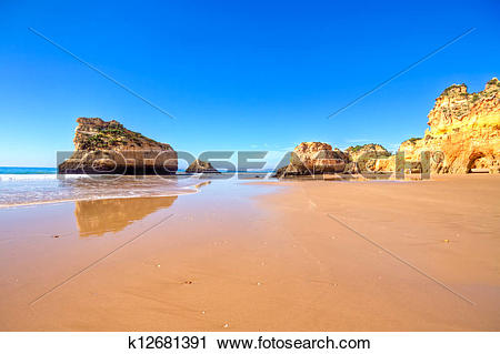 Stock Photography of natural rocks at Praia Tres Irmaos in Alvor.
