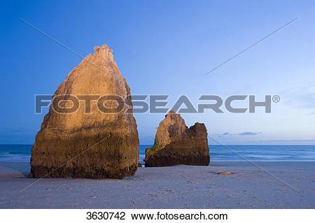 Stock Photo of Praia dos Tres Irmaos at night, Alvor, Algarve.