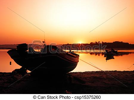 Stock Image of Fishing boat at sunset, Alvor..