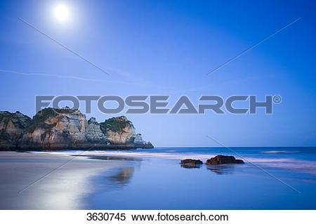 Stock Image of Praia dos Tres Irmaos at night, Alvor, Algarve.