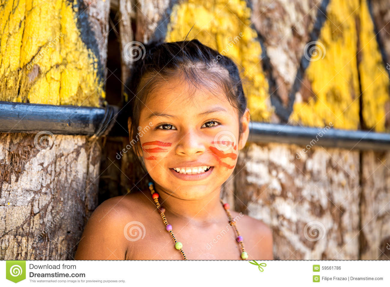 Native Brazilian Girl Smiling At An Indigenous Tribe In The Amazon.