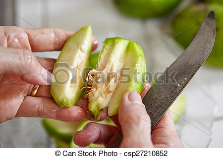 Stock Images of Peeling and cutting ambarella fruit or known as.