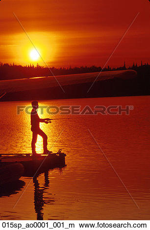 Stock Photo of Man Fishing from Dock Amber Lake Sunset Summer SC.
