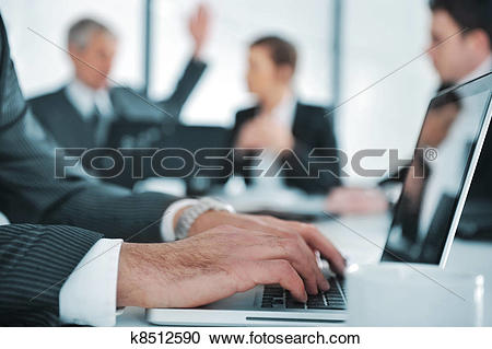 Stock Photography of Business ambience, typing report on laptop.