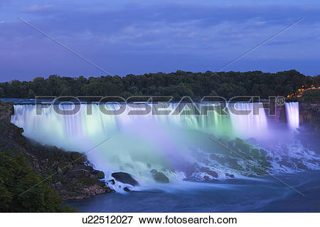Picture of The American Falls lit up at dusk looking towards.