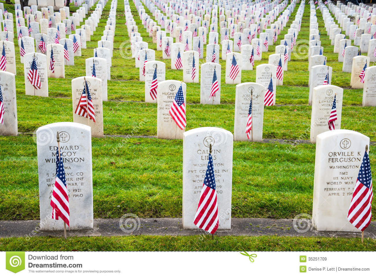 Headstones With American Flags In Arlington Of The West Veterans.